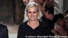 22.06.2016 **** FILE - This Wednesday, June 22, 2016 file photo shows fashion designer Maria Grazia Chiuri acknowledging applause after Valentino's Men's Spring Summer 2017 fashion collection presented in Paris, France. Dior has named Italian designer Maria Grazia Chiuri its new creative director for women's collection, making her the first woman to lead the illustrious French fashion house since it was founded 70 years ago. (AP Photo/Kamil Zihnioglu, File)