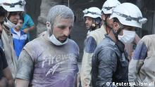Residents and civil defense members look for survivors at a damaged site after what activists said was a barrel bomb dropped by forces loyal to Syria's President Bashar al-Assad in the Al-Shaar neighborhood of Aleppo, Syria. REUTERS/Abdalrhman Ismail Reuters/A. Ismail