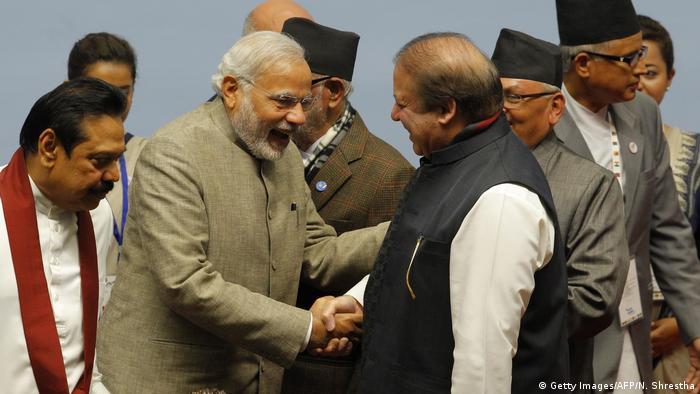 Indian Prime Minister Narendra Modi and Pakistani Prime Minister Nawaz Sharif shake hands at the Nepal SAARC Summit in Kathmandu, 2014
