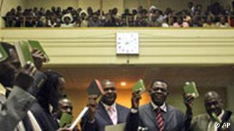 Zimbabwe's ruling party Zanu-PF and opposition party Movement for Democratic Change (MDC) party members are sworn in during the swearing in ceremony for the members of parliament in Harare, Zimbabwe