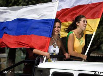 Girls ride on a car while holding Russian and South Ossetian separatists' flags in Tskhinvali, the capital of Georgia's separatist-controlled territory of South Ossetia