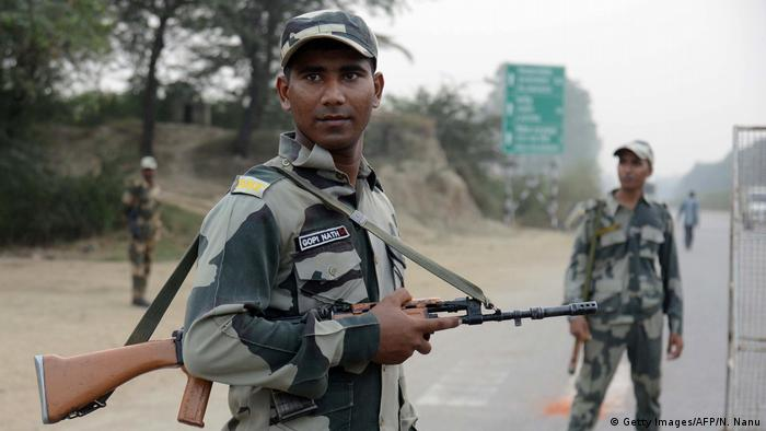 Indian Border Security Force personnel stand guard at the India-Pakistan border