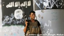Miembro de las fuerzas iraquíes contraterroristas después de expulsar a combatientes del Estado Islámico en la ciudad de Faluya, Irak.