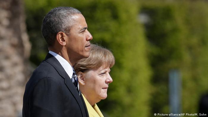 Deutsch Kanzlerin Merkel und US-Präsident Obama (Picture-alliance/AP Photo/M. Sohn)