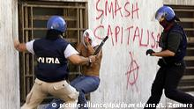 2001 Italian anti-riot policemen beat up a young demonstrator during the clashes that erupted Saturdy, 21 July 2001, in Genoa during the second day of the G8 summit. Ten protestors were taken to hospital, neither of them seriously hurt, but the GSF said that most of those injured preferred to stay away from medical units for fear of being identified. dpa |