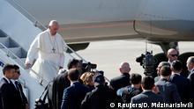 Pope Francis disembarks the papal plane after arriving at the Tbilisi International Airport, Georgia September 30, 2016. REUTERS/David Mdzinarishvili