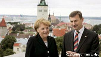 German Chancellor Angela Merkel (R) and Estonian Prime Minister Andrus Ansip stand on a balcony of Stenbock House in Tallinn