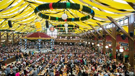Thousands of Oktoberfest-goers in beer tent.