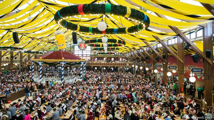 Thousands of Oktoberfest-goers in beer tent.