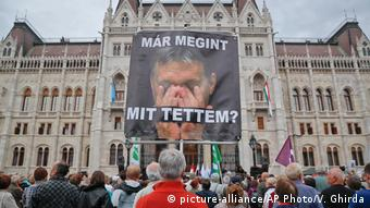 A banner reading 'What have I done again' against a photo of the PM Viktor Orban at an opposition rally in Budapest on Sunday