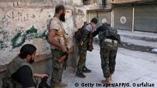September 30, 2016*** Syrian pro-government forces take part in an operation to take control of Aleppo's Suleiman al-Halabi neighbourhood, which is divided by the frontline that separates the rebel-held east and regime-held west of the northern city, on September 30, 2016. Syrian regime forces advanced in the battleground city of Aleppo, backed by a Russian air campaign that a monitor said has killed over 3,800 civilians in the past year. / AFP / GEORGES OURFALIAN (Photo credit should read GEORGES OURFALIAN/AFP/Getty Images)