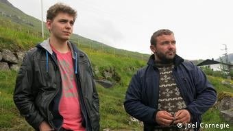 Faroese locals, Petur Sigur and Jens Mortan Rasmussen look out across one of the 23 Grind beaches of the Faroe Islands.