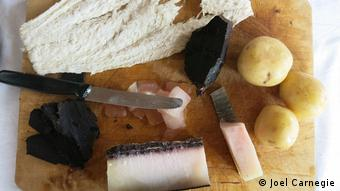 A typical Faroese snack - whale meat, whale blubber and dried fish with boiled potatoes. (Joel Carnegie)