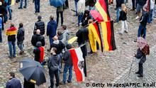 3.10.2016 *** DRESDEN, GERMANY - OCTOBER 03: People attend a ralley of right wing citizens movement Festung Europa (Fortress Europe) on German Unity Day on October 3, 2016 in Dresden, Germany. Unity Day, called Tag der Deutschen Einheit, commemorates German reunification of East and West Germany following the end of the Cold War. This year's celebrations were accompanied by protests from both left and right-wing groups, notably the anti-Muslim and anti-immigration Pegida movement, which has its roots in Dresden, as well as extraordinary security measures by police. (Photo by Carsten Koall/Getty Images) Copyright: Getty Images/AFP/C. Koall