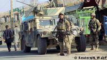 04.10.2016+++ Afghan security forces keep watch in front of their armoured vehicle in Kunduz city, Afghanistan October 4, 2016. +++ (C) Reuters/N. Wakif