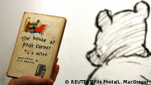 90 Jahre Winnie the Pooh (Pu der Bär) An employee poses with the first American edition of A.A. Milne's Winnie-the-Pooh book 'The House at Pooh Corner' dated 1928 at Sotheby's in London December 15, 2008. REUTERS/Luke MacGregor/File Photo (c) REUTERS/File Photo/L. MacGregor
