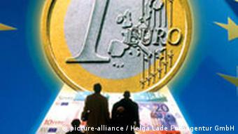 Backlit people walking toward a massive 1 euro coin