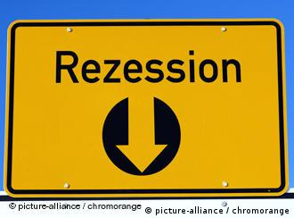 A yellow sign reading 'Rezession' with arrow pointing downwards