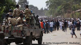 Oromo police officers in a pick up car kee a watch over participants in a religious celebration
