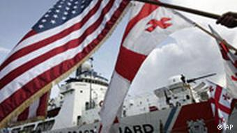 The US Coast Guard cutter Dallas is seen as Georgians wave the US and Georgian flags