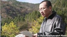 This Oct. 28 2018 photo shows Liu Xiaobo right a letter beside the grave of Bao Zunxin, a chinese historian and political dissident who was arrested and jailed for his role in the 1989 Tiananmen Square democracy protests in Beijing China,