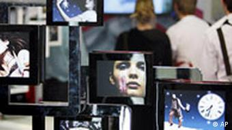 Flat picture frames are seen at the stand of a home entertainment company one day ahead of the official opening of the the consumer electronicis fair 'IFA 2008' in Berlin, Germany, Thursday, Aug. 28, 2008.