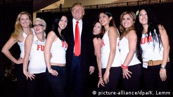 Trump poses with a group of young women