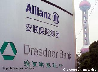 Signboard with logos of Allianz and Dresdner Bank as the Oriental Pearl TV Tower is seen in the background in Liujiazhui Financial District in Pudong, Shanghai, February 22, 2006. Foto: Imaginechina Fa luo +++(c) dpa - Report+++