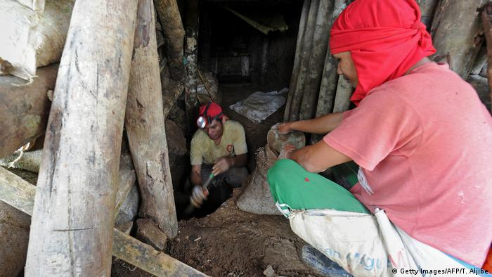 Two small-scale miners digging inside their newly-opened mine tunnel at a site in the village of Mt. Diwata, in the town of Monkayo in the Compostela Valley, Philippines