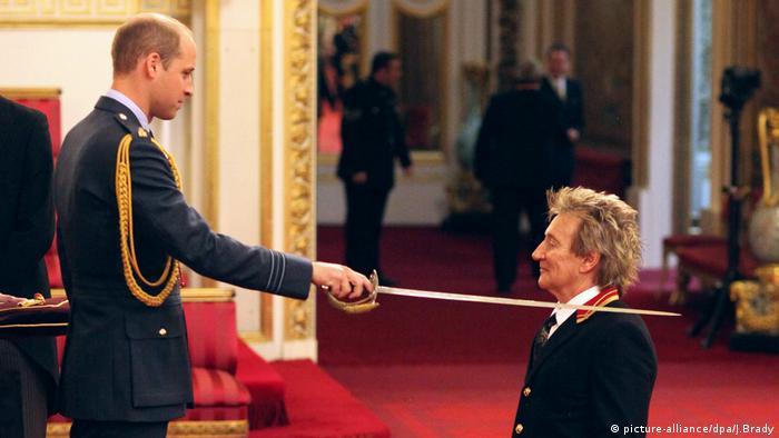 Prince Willliam knighting Rod Stewart in 2016