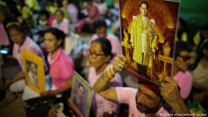 Thais dressed in pink pray for their king's recovery outside the Siriraj Hospital in Bangkok