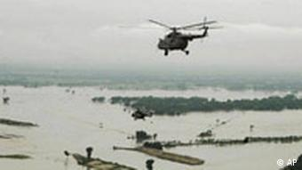 A helicopter carrying Indian Prime Minister Manmohan Singh and Congress party president Sonia Gandhi, makes an aerial survey of flood affected areas in Bihar, India, Thursday, Aug. 28, 2008. The death toll from this year's monsoon has already climbed past 800, and now some 1.2 million people have been marooned, and about 2 million more affected in the impoverished state of Bihar, where the Kosi river has burst its banks, breached safety embankments and submerged all roads leading to the region. (AP Photo)