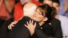 Republican presidential candidate, Sen. John McCain, R-Ariz., left hugs Republican Alaska Gov. Sarah Palin as McCain announces her as his Vice Presidential running mate Friday, Aug. 29, 2008 at Ervin J. Nutter Center in Dayton, Ohio. (AP Photo/Kiichiro Sato)