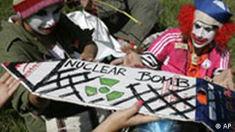 Demonstrators dressed as clowns protest against nuclear bombs at Buechel airbase