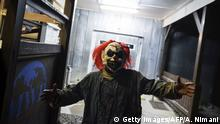 30.10.2015 A U.S soldier wearing a scary clown mask takes part in a Halloween party at the US military camp Bondsteel near the town of Ferizaj on October 30, 2015