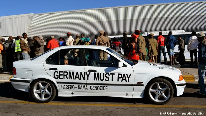 A car marked with the words Germany must pay parked at an airport in Namibia's capital Windhoek.