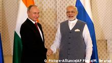 Indian Prime Minister Narendra Modi, right, shakes hand with Russian President Vladimir Putin prior to their annual bilateral meeting, on the sidelines of the BRICS summit, where they are expected to discuss Syria and Afghanistan, in Goa, India, Saturday, Oct. 15, 2016. (AP Photo/Manish Swarup)