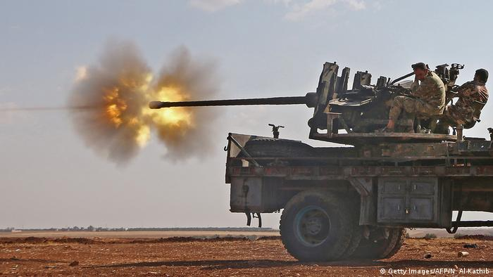 Fighters from the Free Syrian Army fire an anti-aircraft machine gun (Getty Images/AFP/N. Al-Kathib)