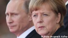 15 October 2016*** OUISTREHAM, FRANCE - JUNE 06: In this file photo German Chancellor Angela Merkel and Russian President Vladimir Putin attend commeoration ceremonies marking the 70th anniversary of the D-day invasion of Nazi-occupied Normandy on June 6, 2014 in Ouistreham, France. Merkel and other leaders of NATO-member states are attending a NATO summit in Newport, Wales, from September 4-5, 2014, and Russia's active involvement in the war in eastern Ukraine is high on the summit agenda. (Photo by Sean Gallup/Getty Images)