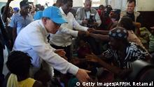 15.10.2016 UN Secretary-General Ban Ki-moon visit a shelter in the Lycee Phillipe Guerrier in the city of Les Cayes, in the southwest of Haiti, on October 15, 2016. Haiti faces a humanitarian crisis that requires a massive response from the international community, the United Nations chief said , with at least 1.4 million people needing emergency aid following last week's battering by Hurricane Matthew. / AFP / HECTOR RETAMAL (Photo credit should read HECTOR RETAMAL/AFP/Getty Images)