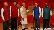 15.10.2016 *** (L-R) Brazil's President Michel Temer, Chinese President Xi Jinping, Indian Prime Minister Narendra Modi, Russian President Vladimir Putin and South African President Jacob Zuma pose infront of a sand sculpture ahead of BRICS (Brazil, Russia, India, China and South Africa) Summit in Benaulim, in the western state of Goa, India, October 15, 2016. REUTERS/Danish Siddiqui