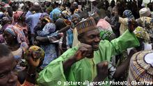 Family members celebrate after being reunited with the kidnapped girls during an church service held in Abuja, Nigeria, Sunday, Oct. 16, 2016. The girls were released Thursday and flown to Abuja, Nigeria's capital, but it's taken days for the parents to arrive. The families came from the remote northeastern town of Chibok, where nearly 300 girls were kidnapped on April 2014 in a mass abduction that shocked the world. Dozens of schoolgirls escaped in the first few hours but after last week's release, 197 remain captive. (AP Photo/Olamikan Gbemiga) |
