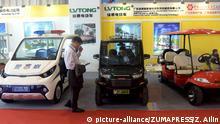 NANNING, Sept. 12, 2016 (Xinhua) -- Visitors view electric vehicles during the 13th China-ASEAN Expo in Nanning, capital of south China's Guangxi Zhuang Autonomous Region, Sept. 12, 2016. (Xinhua/Zhang Ailin) (wyo |