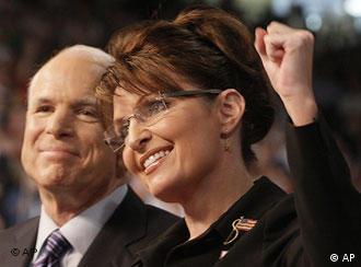 Presumptive Republican presidential nominee Sen. John McCain, left, smiles as his Vice Presidential running mate, Alaska Gov. Sarah Palin, pumps her fist.