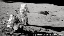 Feb 5, 2015 - Moon, Space - On Feb. 5. 1971, the Apollo 14 crew module landed on the moon. The crew members were Captain Alan Bartlett Shepard, Jr. (USN), commander; Major Stuart Allen Roosa (USAF), command module pilot; and Commander Edgar Dean Mitchell (USN), lunar module pilot. In this photo, Shepard stands by the Modular Equipment Transporter (MET). The MET was a cart for carrying around tools, cameras and sample cases on the lunar surface. Shepard can be identified by the vertical stripe on his helmet. After Apollo 13, the commander's spacesuit had red stripes on the helmet, arms, and one leg, to help identify them in photographs |