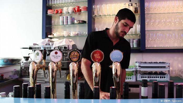 Bartender Suri Zayat pulls a beer