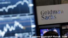 """ARCHIV FILE - In this Oct. 16, 2014, file photo, a screen at a trading post on the floor of the New York Stock Exchange is juxtaposed with the Goldman Sachs booth. Goldman Sachs unveiled its long-awaited online consumer lending service called """"Marcus"""" on Thursday, Oct. 13, 2016, the investment bank's latest push to traditional retail banking products. Eligible customers will be able borrow up to $30,000 from Marcus as fixed-rate, no-fee, unsecured personal loans, with terms from two to six years. (AP Photo/Richard Drew, File)"""