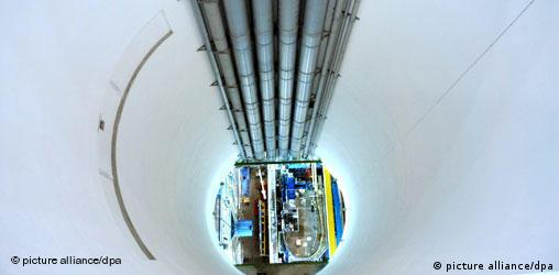 A white tunnel at the bottom of which is a section of a laboratory