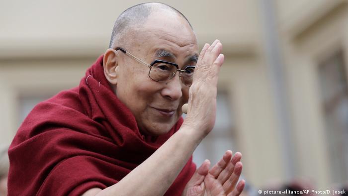 Tibetan spiritual leader the Dalai Lama greets his supporters