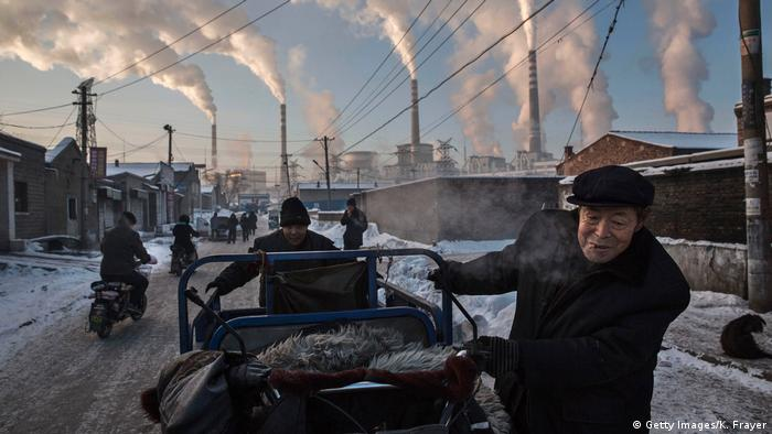 Smokestacks at a coal power plant billowing smoke in Shanxi, China, in November 2016 (Getty Images/K. Frayer)